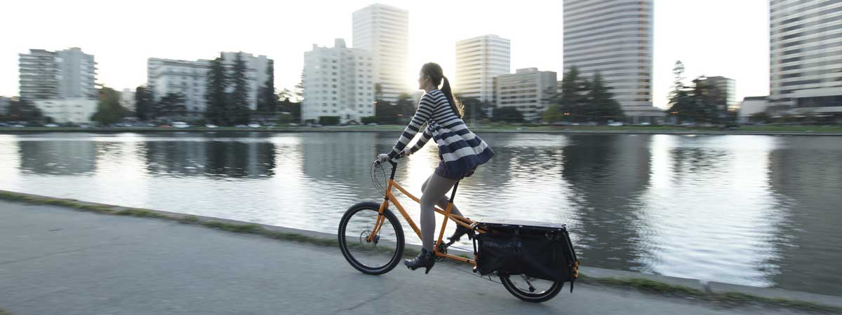 Woman commuting in the city on an Xtracycle cargo bike