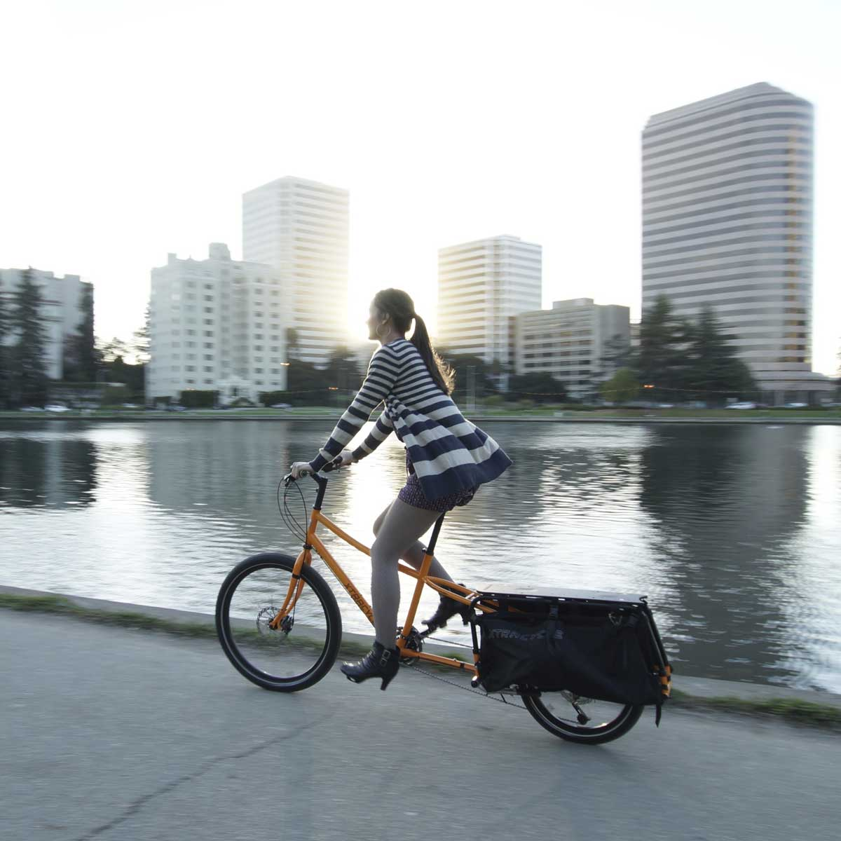 woman commuting to work xtracycle cargo bike riverside